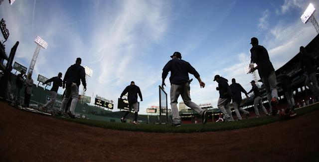 Detroit Tigers stretch during the baseball team's workout at Fenway Park in Boston, Friday, Oct. 11, 2013. The Tigers will face the Boston Red Sox in Game 1 of the American League championship series on Saturday. (AP Photo/Charlie Riedel)