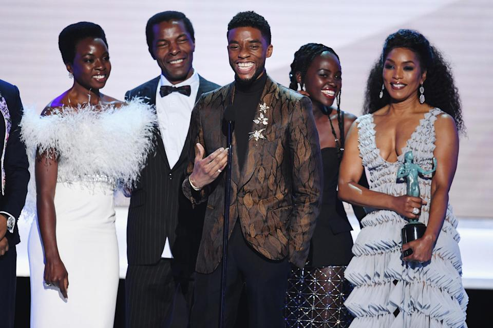 Some of the Black Panther cast accept an award on stage