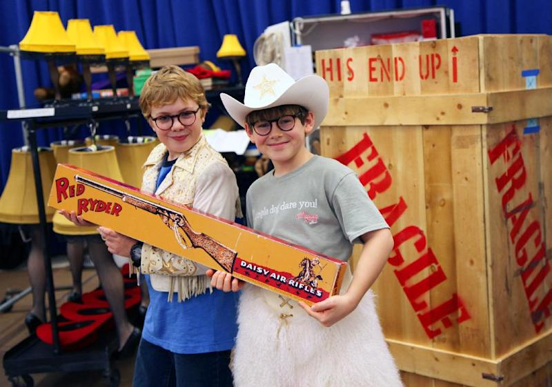 """In this Oct. 26, 2012, photo, Joe West, left, and Johnny Rabe hold a Red Ryder BB Gun, one of the props from """"A Christmas Story, the Musical"""" in New York. Both 12-year-old boys are making their Broadway debuts playing Ralphie in the stage adaptation of the cult 1983 film. (AP Photo/Mark Kennedy)"""