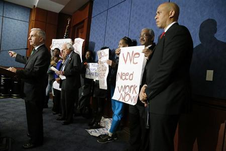 Reed and Booker hold news conference with unemployed Americans to highlight their political divide with Republicans over unemployment insurance legislation, at U.S. Capitol in Washington