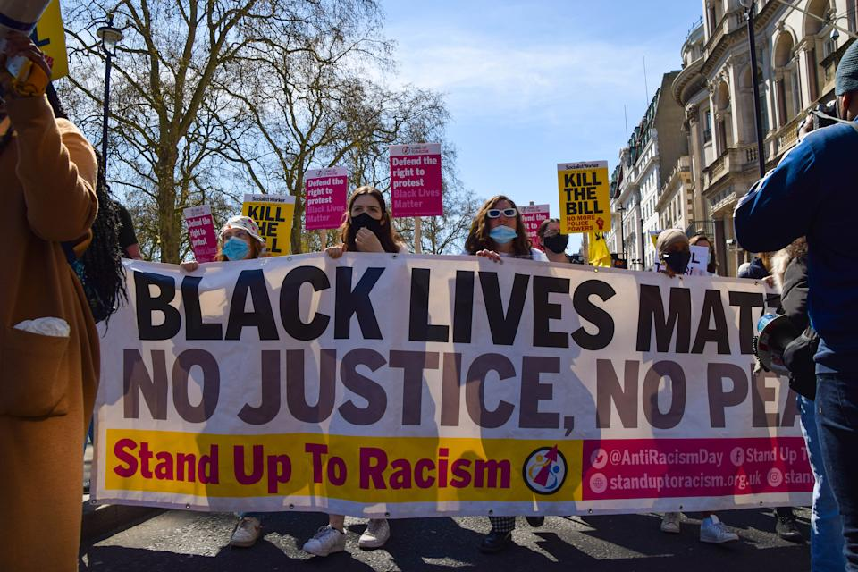 LONDON, UNITED KINGDOM - 2021/04/17: Protesters hold a Black Lives Matter banner and placards during the Kill The Bill demonstration. Crowds once again marched in protest against the Police, Crime, Sentencing and Courts Bill. (Photo by Vuk Valcic/SOPA Images/LightRocket via Getty Images)