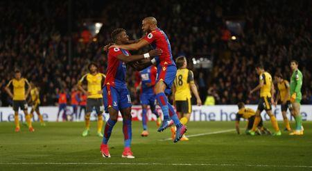 Britain Football Soccer - Crystal Palace v Arsenal - Premier League - Selhurst Park - 10/4/17 Crystal Palace's Andros Townsend celebrates scoring their first goal with Wilfried Zaha  Reuters / Stefan Wermuth