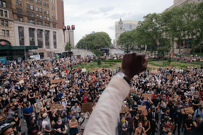 Demonstrators gather outside Brooklyn Borough Hall in New York, on June 5, 2020, in protest against police brutality and the killing of George Floyd in Minneapolis police custody. (Amir Hamja/The New York Times)
