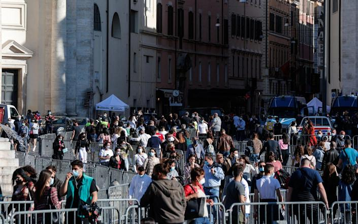 People enjoy a sunny day during the last weekend in the orange zone, in Rome - Giuseppe Lami/EPA-EFE/Shutterstock