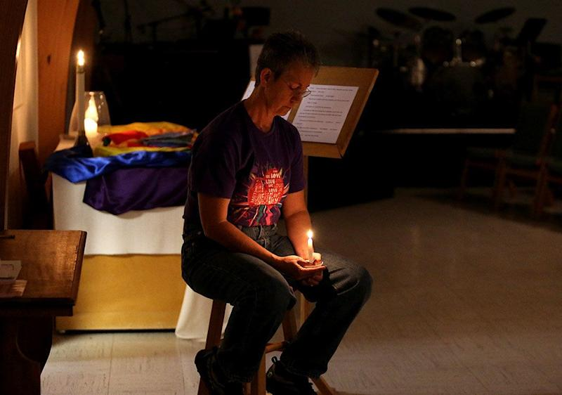 Rev. Dee Lundberg holds a vigil at Casper's United Church Of Christ after the deadly mass shooting in Las Vegas.