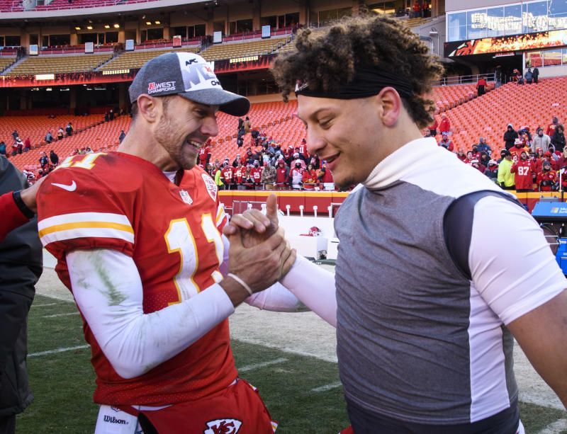Former Chiefs quarterback Alex Smith (11) and Patrick Mahomes (15) celebrate after a win against the Dolphins last season. (AP)