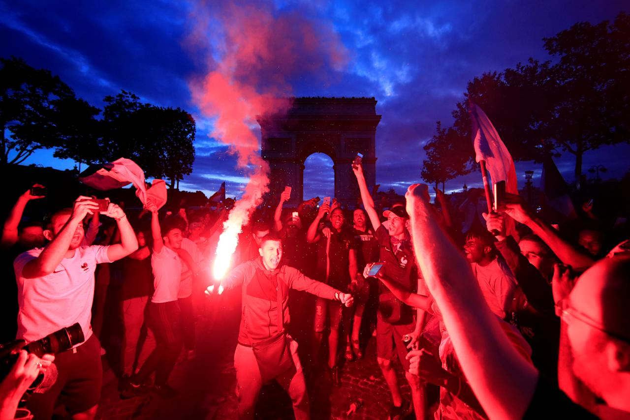 <p>France fans react on the Champs-Elysees after defeating Belgium in their World Cup semi-final match. REUTERS/Gonzalo Fuentes </p>