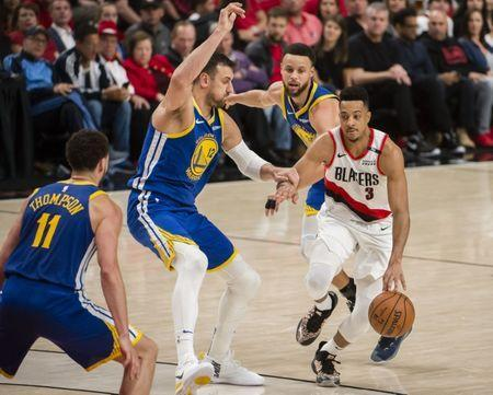 May 20, 2019; Portland, OR, USA; Portland Trail Blazers guard CJ McCollum (3) is double teamed in the second half by Golden State Warriors center Andrew Bogut (12) and guard Stephen Curry (30) in game four of the Western conference finals of the 2019 NBA Playoffs at Moda Center. The Warriors won 119-117 in overtime. Mandatory Credit: Troy Wayrynen-USA TODAY Sports