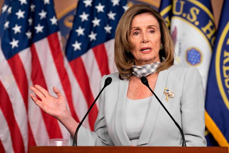 Nancy Pelosi defended the US Postal Service at her weekly press briefing: AFP via Getty Images