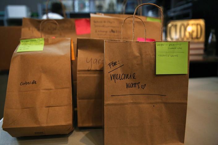 "In May, books were bagged and ready for curbside customer pickup at the Last Bookstore in downtown L.A. <span class=""copyright"">(Dania Maxwell / Los Angeles Times)</span>"