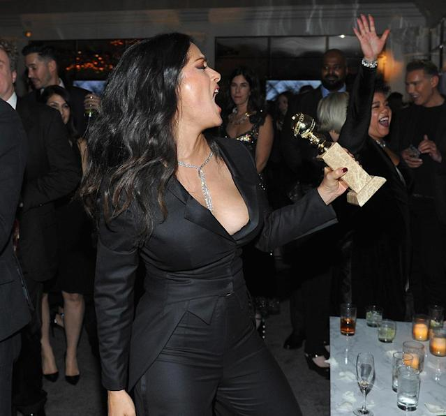 <p>Salma Hayek had some fun with a Golden Globe at the 2018 InStyle and Warner Bros. party. (Photo: Donato Sardella/Getty Images for InStyle ) </p>