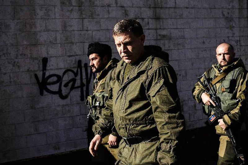 Pro-Russian gunmen guard Alexander Zakharchenko (C), Prime Minister of the self-proclaimed Donetsk Peoples Republic and presidential candidate on October 31, 2014 in Donetsk (AFP Photo/Dimitar Dilkoff)