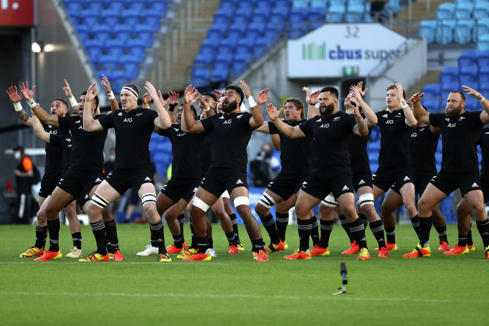 New Zealand players perform the haka, a traditional Maori challenge, ahead of their Rugby Championship match against Argentina on Sunday, Sept. 12, 2021, on the Gold Coast, Australia. (AP Photo/Tertius Pickard)