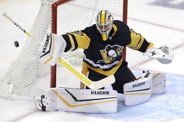 Pittsburgh Penguins goaltender Matt Murray blocks a shot during the first period of an NHL hockey game against the Winnipeg Jets in Pittsburgh, Tuesday, Oct. 8, 2019. (AP Photo/Gene J. Puskar)