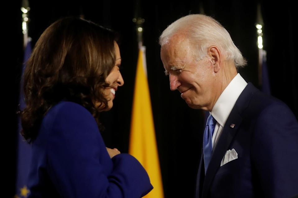Democratic presidential candidate and former Vice President Joe Biden and vice presidential candidate Senator Kamala Harris are seen at the stage during a campaign event, their first joint appearance since Biden named Harris as his running mate, at Alexis Dupont High School in Wilmington, Delaware, U.S., August 12, 2020. REUTERS/Carlos Barria
