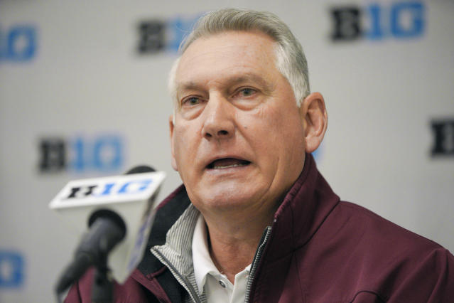 FILE - In this May 21, 2019, file photo, Minnesota coach John Anderson speaks during a news conference ahead of the Big Ten NCAA college baseball tournament in Omaha, Neb. A new rule intended to help speed up the game also could thwart attempts to steal signs in college baseball. The NCAA will allow a pitcher to wear a wristband with a signal card when the season opens Friday, Feb. 14, 2020, allowing him and the catcher to look into the dugout to get pitch calls and eliminating the need for the catcher to relay the call with hand signs. (AP Photo/Nati Harnik, File)