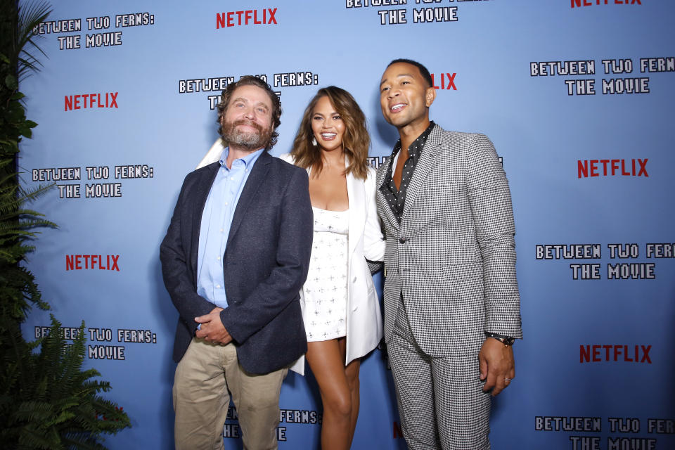 """LOS ANGELES, CALIFORNIA - SEPTEMBER 16: (L-R) Zach Galifianakis, Chrissy Teigen, and John Legend attend Netflix's special screening of """"Between Two Ferns: The Movie"""" on September 16, 2019 in Los Angeles, California. (Photo by Rachel Murray/Getty Images for Netflix)"""