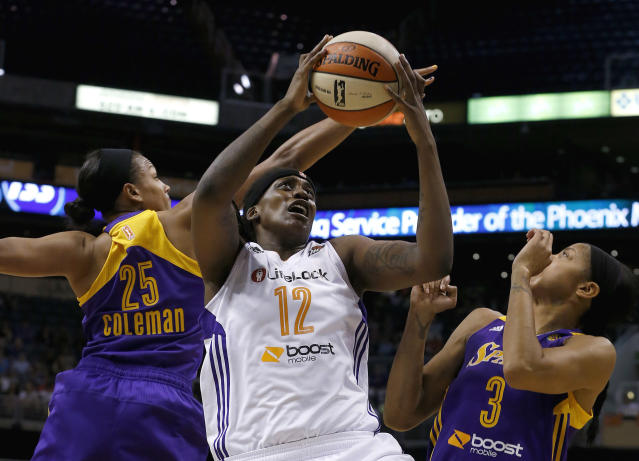 Phoenix Mercury's Lynetta Kizer (12) goes up for a shot against Los Angeles Sparks' Marissa Coleman (25) and Candace Parker (3) during the first half in a WNBA basketball game on Friday, June 14, 2013, in Phoenix. (AP Photo/Ross D. Franklin)