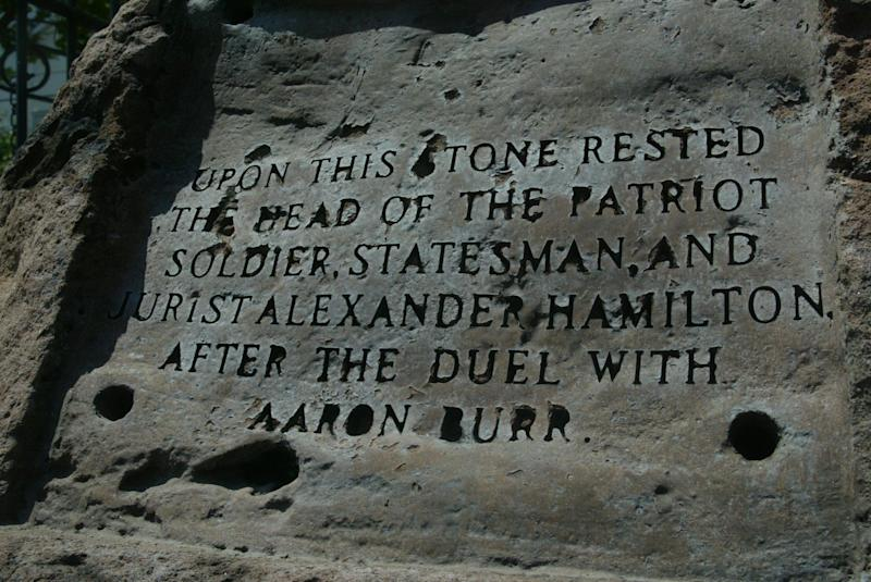 July 7, 2004: According to the engraving on a stone next to the bust of Alexander Hamilton is where he rested his head before dying in a duel with Aaron Burr 200 years ago.