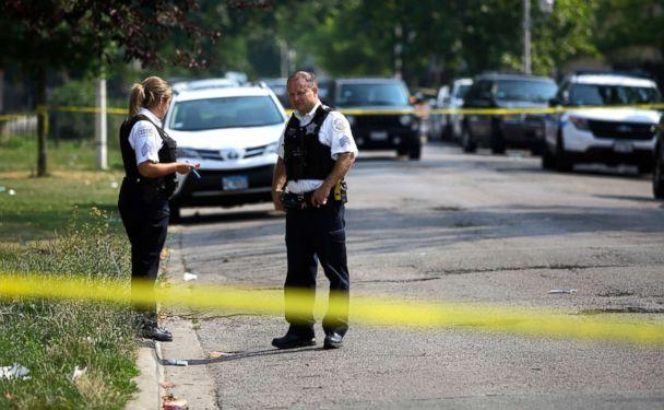 PHOTO: Chicago Police officers investigate a crime scene where a man was shot in the arm, August 12, 2018. According to statistics Chicago has more victims shootings and stabbings than both New York City and Los Angeles together. (Joshua Lott/EPA via Shutterstock )