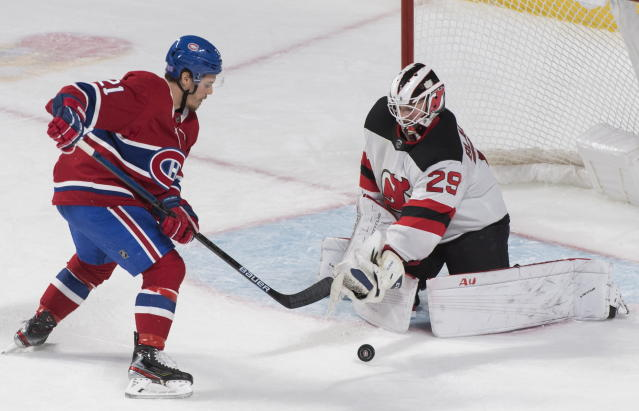 Montreal Canadiens' Nick Cousins moves in against New Jersey Devils goaltender Mackenzie Blackwood during second-period NHL hockey game action in Montreal, Thursday, Nov. 28, 2019. (Graham Hughes/The Canadian Press via AP)