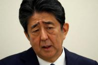 Former Japanese PM Shinzo Abe holds a news conference in Tokyo