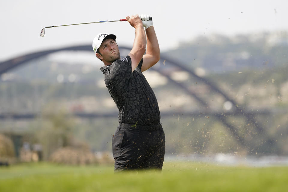 Jon Rahm, of Spain, hits his second shot on the 14th fairway during a round of eight match at the Dell Technologies Match Play Championship golf tournament Saturday, March 27, 2021, in Austin, Texas. (AP Photo/David J. Phillip)