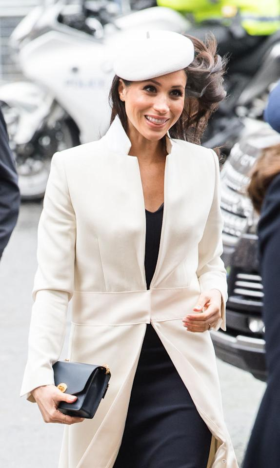 <p><strong>When: March 12, 2018</strong><br />The bride-to-be stood out in a white cream coat by Amanda Wakeley and paired it with a matching fascinator by Stephen Jones. <em>(Photo: Getty)</em> </p>