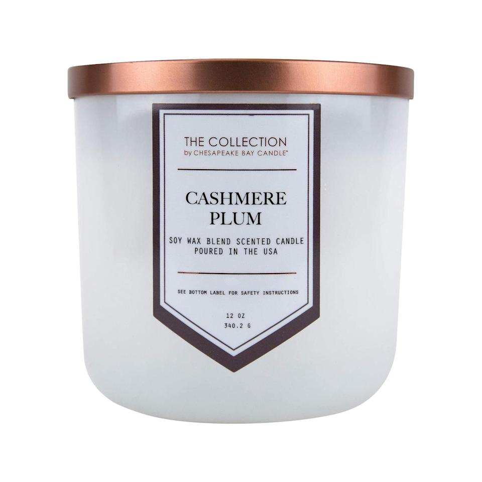 """We're not even sure what """"cashmere plum"""" means, but we'll never forget our first cashmere plum candle we impulse-bought at Target. Well under $15, this trusty candle seems to capture the essence of festivity in the weeks leading up to the holidays. We're down to relive this one at least once a year, an ode to our early candle collecting days. $10.59, Amazon. <a href=""""https://www.amazon.com/Chesapeake-Bay-Candle-Collection-Two-Wick/dp/B077V3959Y"""" rel=""""nofollow noopener"""" target=""""_blank"""" data-ylk=""""slk:Get it now!"""" class=""""link rapid-noclick-resp"""">Get it now!</a>"""