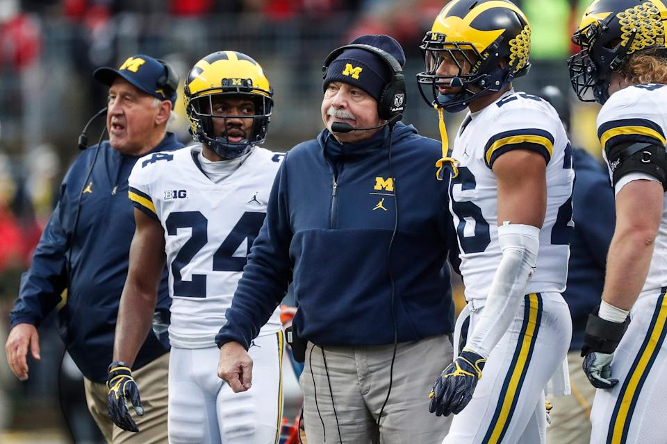 Michigan defensive coordinator Don Brown talks to players during the first half against Ohio State at Ohio Stadium in Columbus, Ohio, Saturday, Nov. 24, 2018.