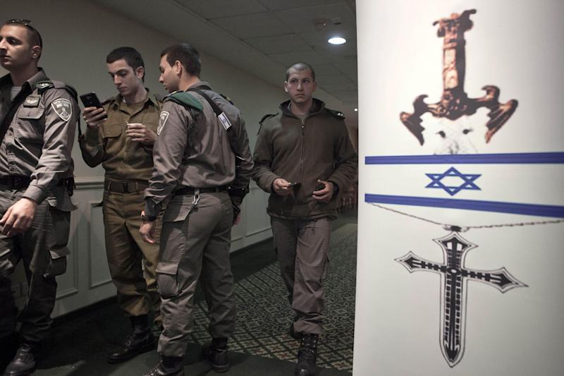 "In this photograph made on Sunday, Dec. 22, 2013, Israeli soldiers stand during the ""Israeli Christians Recruitment Forum"" in Nazareth. Army service in Israel is mandatory for Jews, though not all are called up. Druze leaders signed up their community for army service in the 1950s, and Druze men have been conscripted ever since, while Muslims and Christians are not required to serve. (AP Photo/Dan Balilty)"