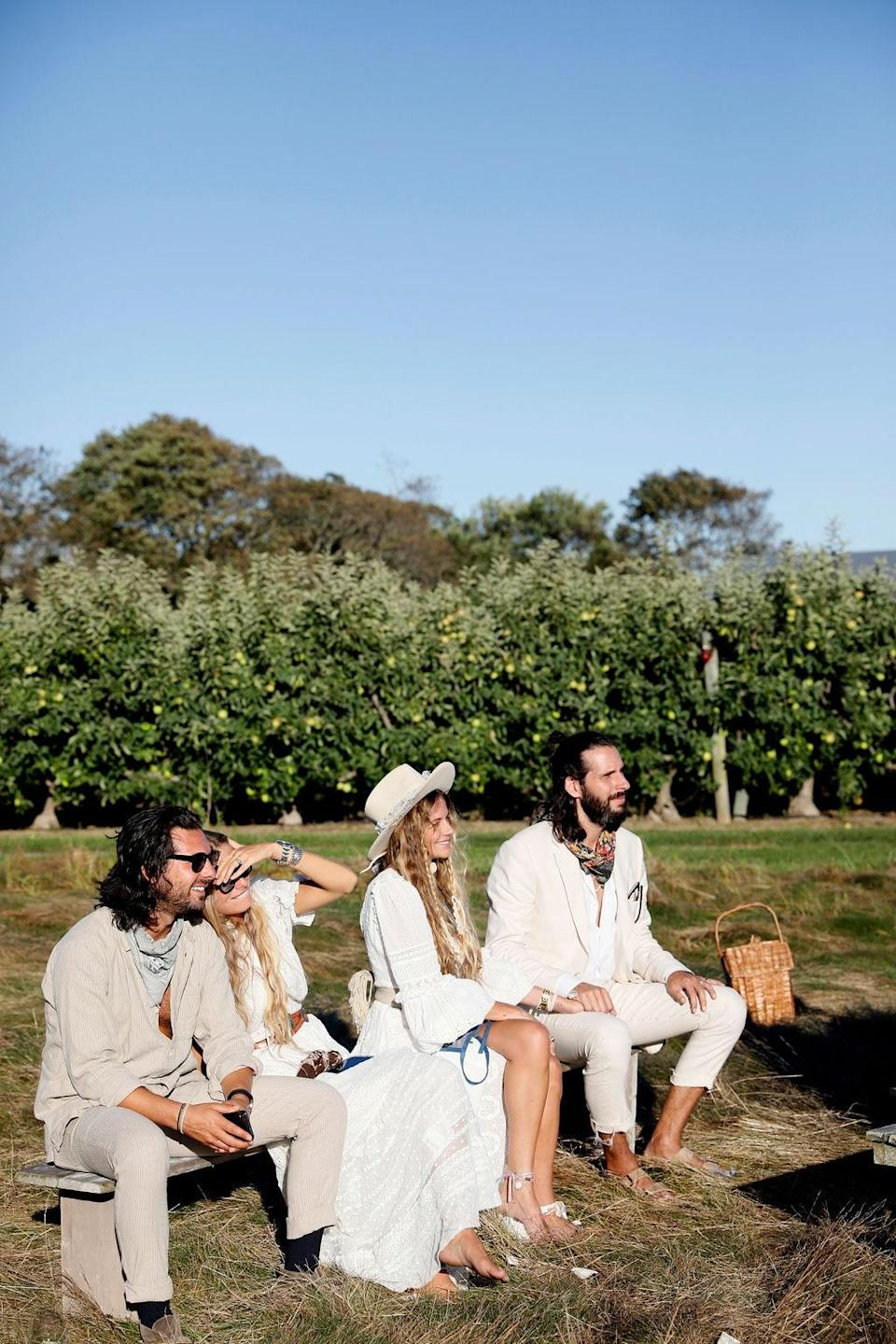 """""""Pamela Tick and her husband Ryan, along with Christina Coniglio and husband Adam Silverstein shield their eyes from the bright summer sun,"""" Dean says. """"The night before, Rebecca and the girls were sharing old vintage Ralph Lauren campaign photos from the early 90s for wedding inspiration after our small family pre-rehearsal dinner."""""""