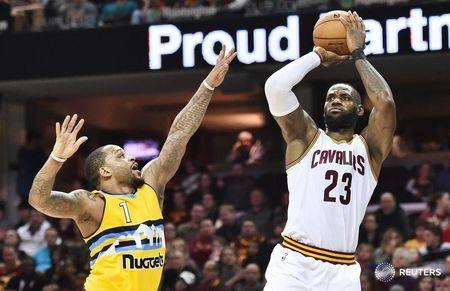 Feb 11, 2017; Cleveland, OH, USA; Cleveland Cavaliers forward LeBron James (23) shoots over Denver Nuggets guard Jameer Nelson (1) during the second half at Quicken Loans Arena. The Cavs won 125-109. Mandatory Credit: Ken Blaze-USA TODAY Sports
