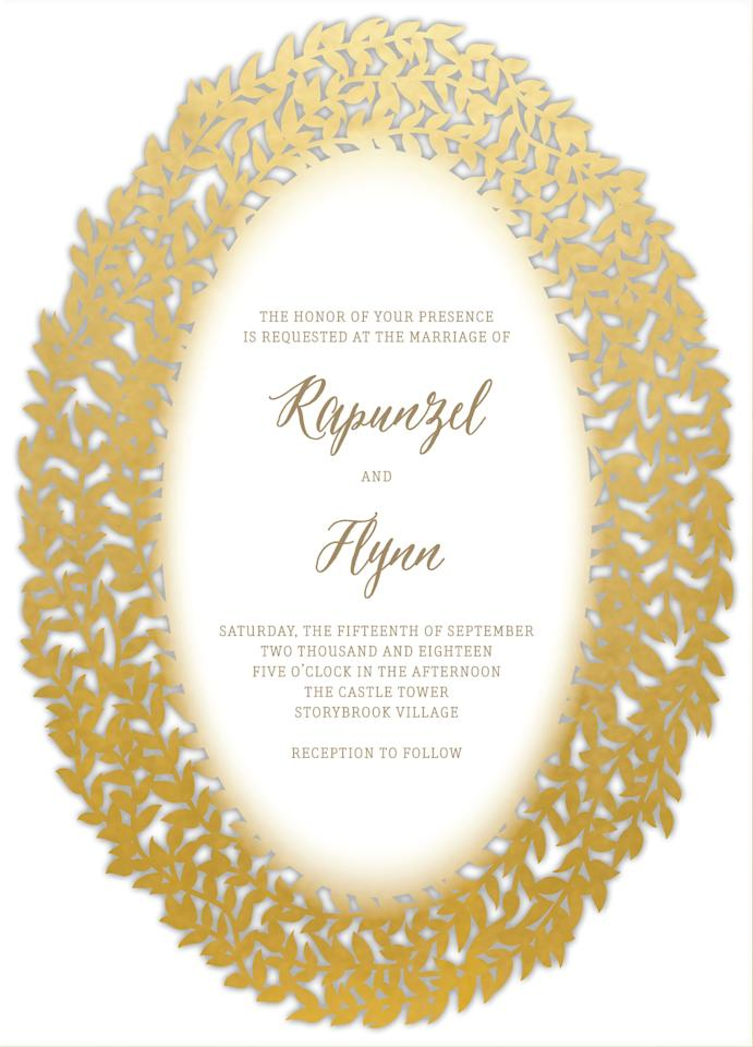 """<p>The intricate laser-cut design of <a rel=""""nofollow"""" href=""""https://www.weddingpaperdivas.com/product/22067/signature_laser_cut_wedding_invitations_elegant_surrounding.html?mbid=synd_yahoostyle&productTest=1"""">these metallic cards</a> is a beautiful homage to the bride's magical golden locks—those tresses did bring these two crazy kids together, after all!</p>"""