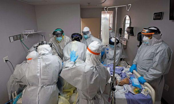 PHOTO: Dr. Joseph Varon, right, leads a team as they try to save the life of a patient unsuccessfully inside the Coronavirus Unit at United Memorial Medical Center, Monday, July 6, 2020, in Houston. (David J. Phillip/AP)