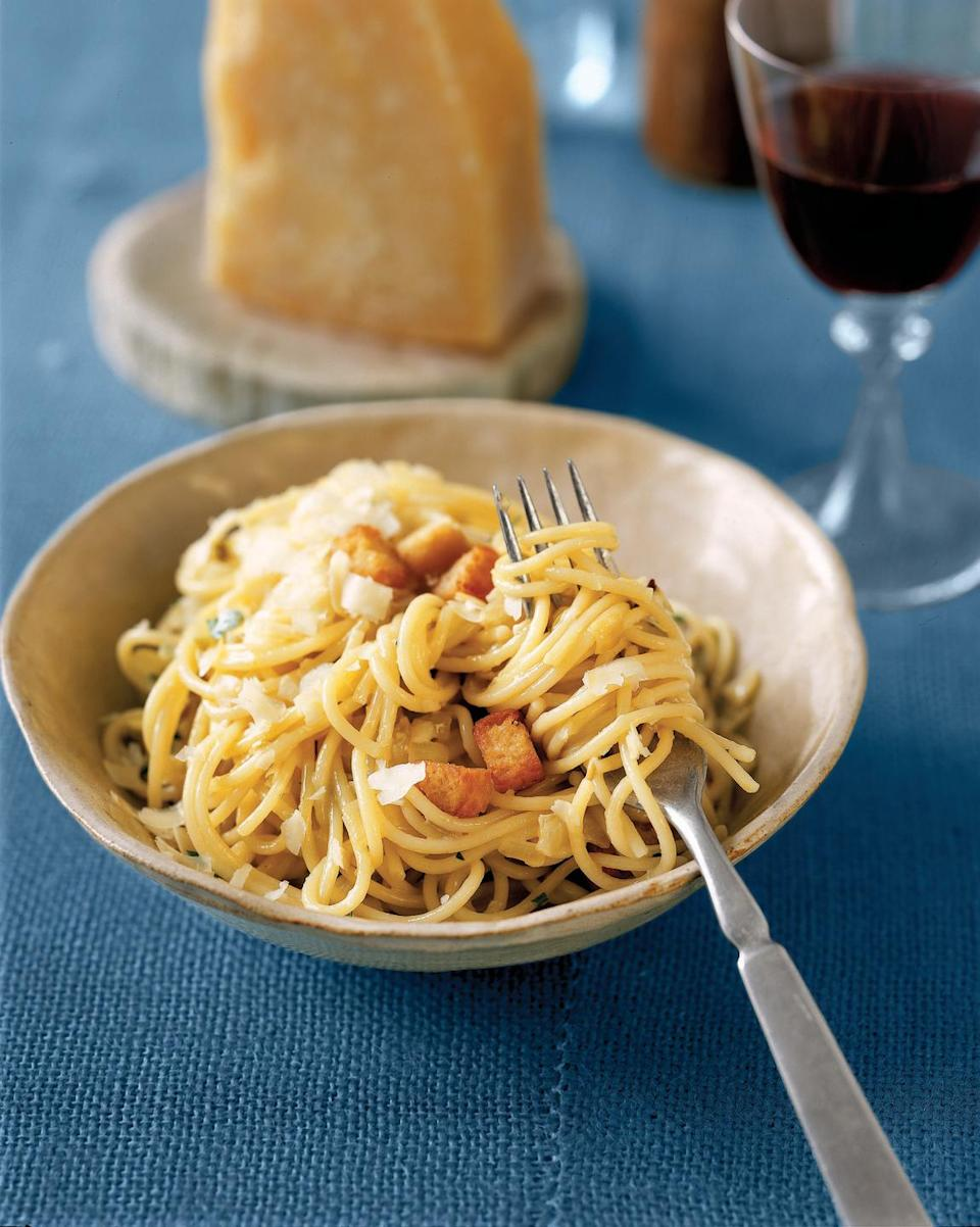 """<p>Quick pasta begins with basic ingredients, such as mushrooms, onions, and red peppers. An egg yolk is tossed with the ingredients and heated through before serving to glaze the pasta in rich, creamy flavor. Finish with a sprinkle of a fragrant, nutty cheese.</p><p><strong><a href=""""https://www.countryliving.com/food-drinks/recipes/a791/easy-pantry-pasta/"""" rel=""""nofollow noopener"""" target=""""_blank"""" data-ylk=""""slk:Get the recipe."""" class=""""link rapid-noclick-resp"""">Get the recipe.</a></strong></p>"""