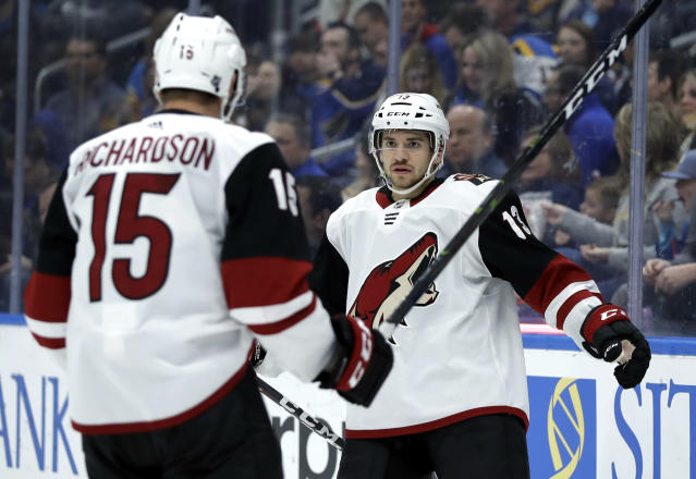Arizona Coyotes' Vinnie Hinostroza, right, is congratulated by Brad Richardson after scoring during the third period of an NHL hockey game against the St. Louis Blues, Tuesday, March 12, 2019, in St. Louis. The Coyotes won 3-1. (AP Photo/Jeff Roberson)