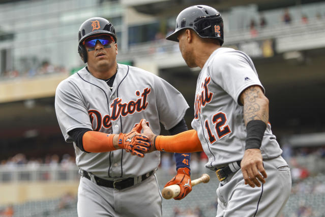 Detroit Tigers Victor Martinez celebrates the run scored by Leonys Martin (12) after he hit a sacrifice fly against the Minnesota Twins to score him in the first inning of a baseball game Wednesday, May 23, 2018, in Minneapolis. (AP Photo/Bruce Kluckhohn)