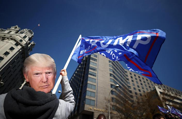 """Supporters of President Trump participate in a """"Stop the Steal"""" protest on Saturday. (Hannah McKay/Reuters)"""