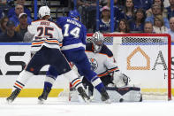 Edmonton Oilers goaltender Mike Smith makes a save against Tampa Bay Lightning's Pat Maroon as Darnell Nurse defends during the first period of an NHL hockey game Thursday, Feb. 13, 2020, in Tampa, Fla. (AP Photo/Mike Carlson)