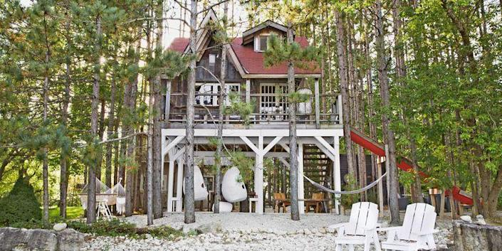 """<p>Inside this treehouse-inspired tiny cabin, you'll find salvaged church windows, reclaimed wood, and a funky dining table set crafted from old boats. </p><p><a class=""""link rapid-noclick-resp"""" href=""""https://www.countryliving.com/home-design/house-tours/g20876637/canadian-tiny-house-cabin/"""" rel=""""nofollow noopener"""" target=""""_blank"""" data-ylk=""""slk:SEE INSIDE"""">SEE INSIDE</a></p>"""