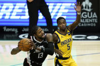 Indiana Pacers guard Edmond Sumner (5) defends against Los Angeles Clippers guard Paul George (13) during the third quarter of an NBA basketball game, Sunday, Jan. 17, 2021, in Los Angeles. (AP Photo/Ashley Landis)