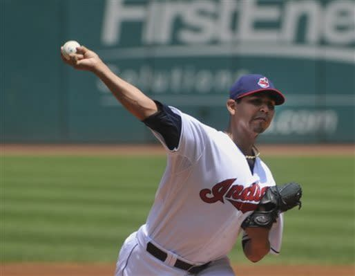 Cleveland Indians pitcher Carlos Carrasco delivers a pitch to Minnesota Twins' Clete Thomas during the first inning of a baseball game in Cleveland, Sunday, June 23, 2013. (AP Photo/Phil Long)