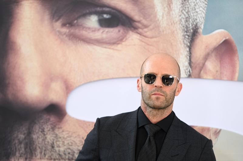 Jason Statham doesn't need more than one try to hit the bottle cap challenge.