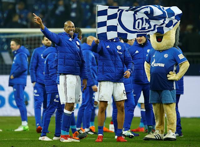 Soccer Football - Bundesliga - Schalke 04 vs TSG 1899 Hoffenheim - Veltins-Arena, Gelsenkirchen, Germany - February 17, 2018 Schalke's Naldo and Franco Di Santo celebrate after the match REUTERS/Leon Kuegeler DFL RULES TO LIMIT THE ONLINE USAGE DURING MATCH TIME TO 15 PICTURES PER GAME. IMAGE SEQUENCES TO SIMULATE VIDEO IS NOT ALLOWED AT ANY TIME. FOR FURTHER QUERIES PLEASE CONTACT DFL DIRECTLY AT + 49 69 650050