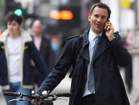 FILE PHOTO: Britain's Secretary of State for Health Jeremy Hunt walks towards Downing Street in London