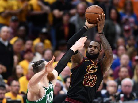 May 21, 2018; Cleveland, OH, USA; Cleveland Cavaliers forward LeBron James (23) attempts a three point shot over Boston Celtics center Aron Baynes (46) during the forth quarter in game four of the Eastern conference finals of the 2018 NBA Playoffs at Quicken Loans Arena. Mandatory Credit: Ken Blaze-USA TODAY Sports