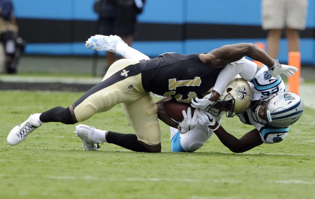 <p>New Orleans Saints' Michael Thomas (13) is tackled after a catch by Carolina Panthers' Daryl Worley (26) in the first half of an NFL football game in Charlotte, N.C., Sunday, Sept. 24, 2017. (AP Photo/Mike McCarn) </p>