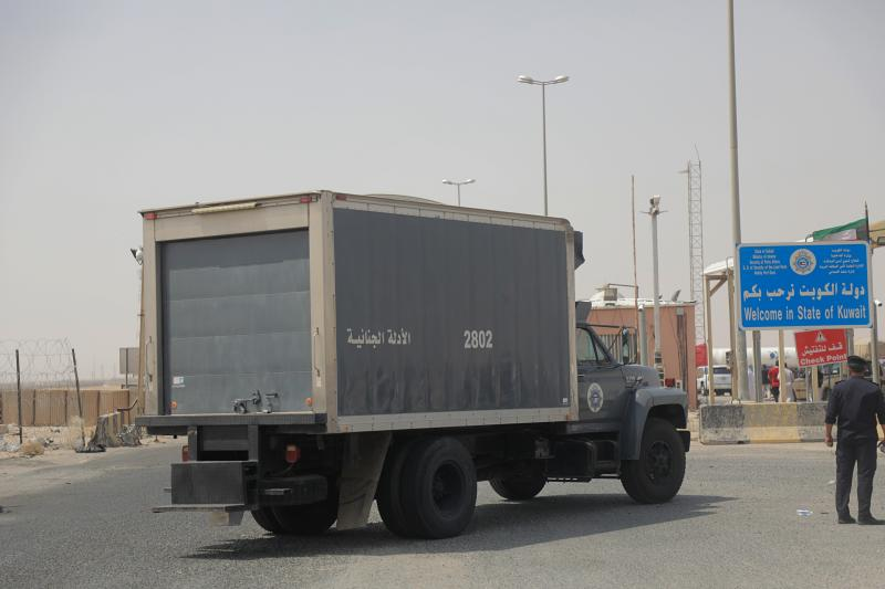 A Kuwaiti truck heads to Kuwait carrying the remains of 48 Kuwaiti citizens after a handover ceremony at the Safwan border crossing, Iraq, Thursday, Aug. 8, 2019. Iraqi and Kuwaiti state media said Iraq has handed over to Kuwait the remains of 48 Kuwaitis who went missing during the 1991 Gulf War. (AP Photo)