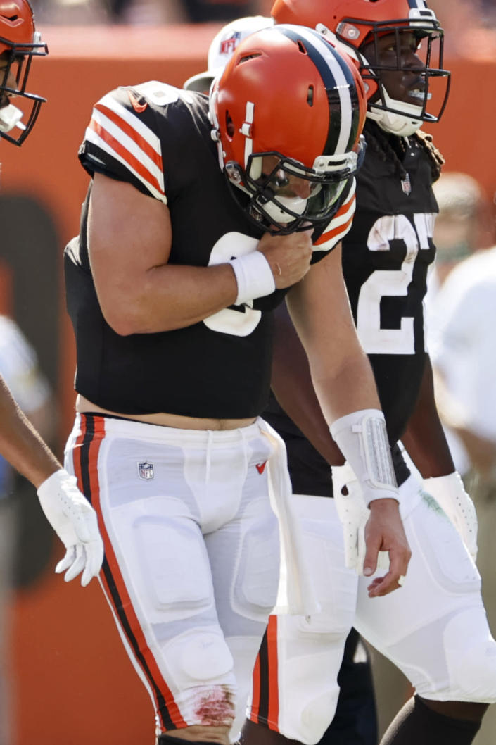 Cleveland Browns quarterback Baker Mayfield holds his shoulder after getting hurt during the first half of an NFL football game against the Houston Texans, Sunday, Sept. 19, 2021, in Cleveland. (AP Photo/Ron Schwane)